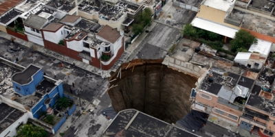 ANOTHER SINK-HOLE SWALLOWS A 3 STORY BUILDING!