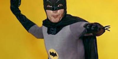 I am Bruce Wayne known as BATMAN!, the dark night, the caped crusader, or a giraffe