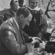 Hitler signing his autograph for a Christian fan