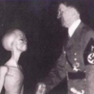 Hitler Shaking hands with  a Small Grey during WW2.