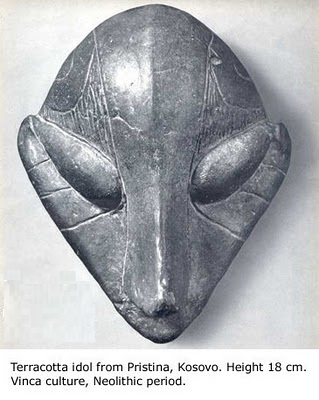Terracota mask of a grey alien